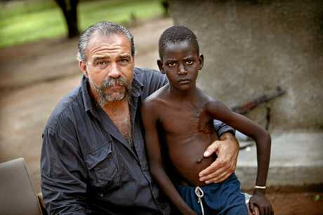 Sam Childers at an orphanage in Sudan 2009 with Samuel, one of his children.