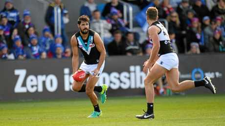 Patrick Ryder of the Power (left) during the round 22 AFL clash with the Bulldogs in Ballarat.