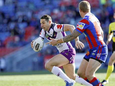 Billy Slater of the Storm looks for a hole in the Knights defence.