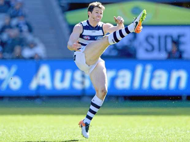 Patrick Dangerfield of the Cats kicks long against the Magpies.