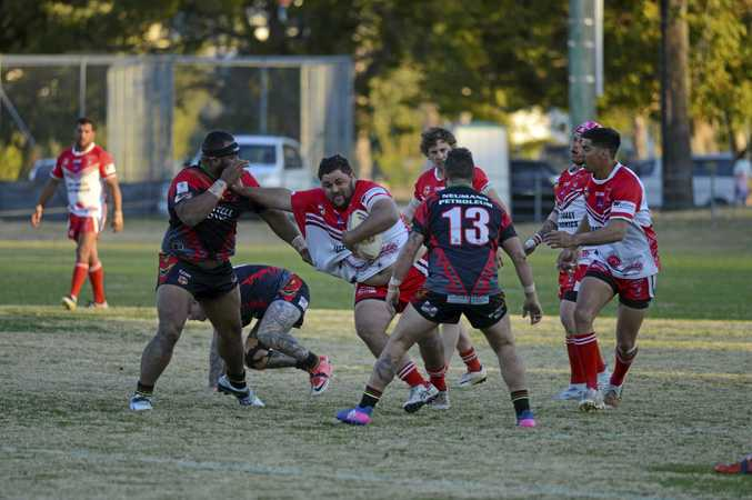 Jeff Skeen tries to break through a line of Panthers at the South Grafton Rebels vs Sawtell Panthers game on Saturday, August 19.