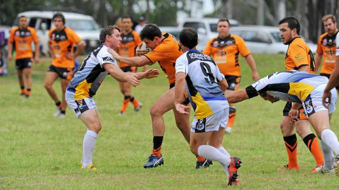 PUSH: Avondale forward Sam Kuhnel tries to break through the Northern Force defence in their 11 try win on Sunday.