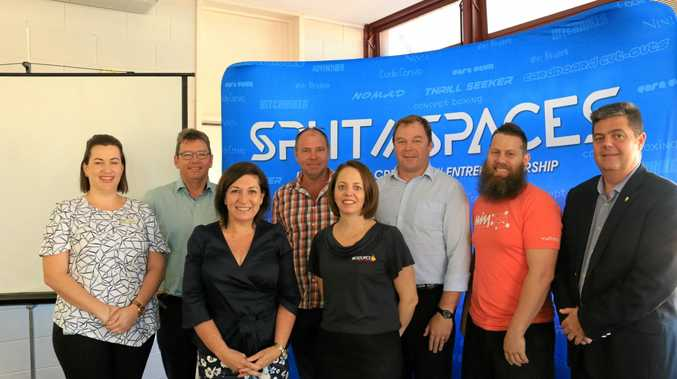 Teona Lewis, Garry Scanlan, Minister Leeanne Enoch, Frank Mason, Adrienne Rourke, Ben Wearmouth, Jarryd Townsend and Pierre Viljoen just after the State Government gave an innovation grant of $480,000.
