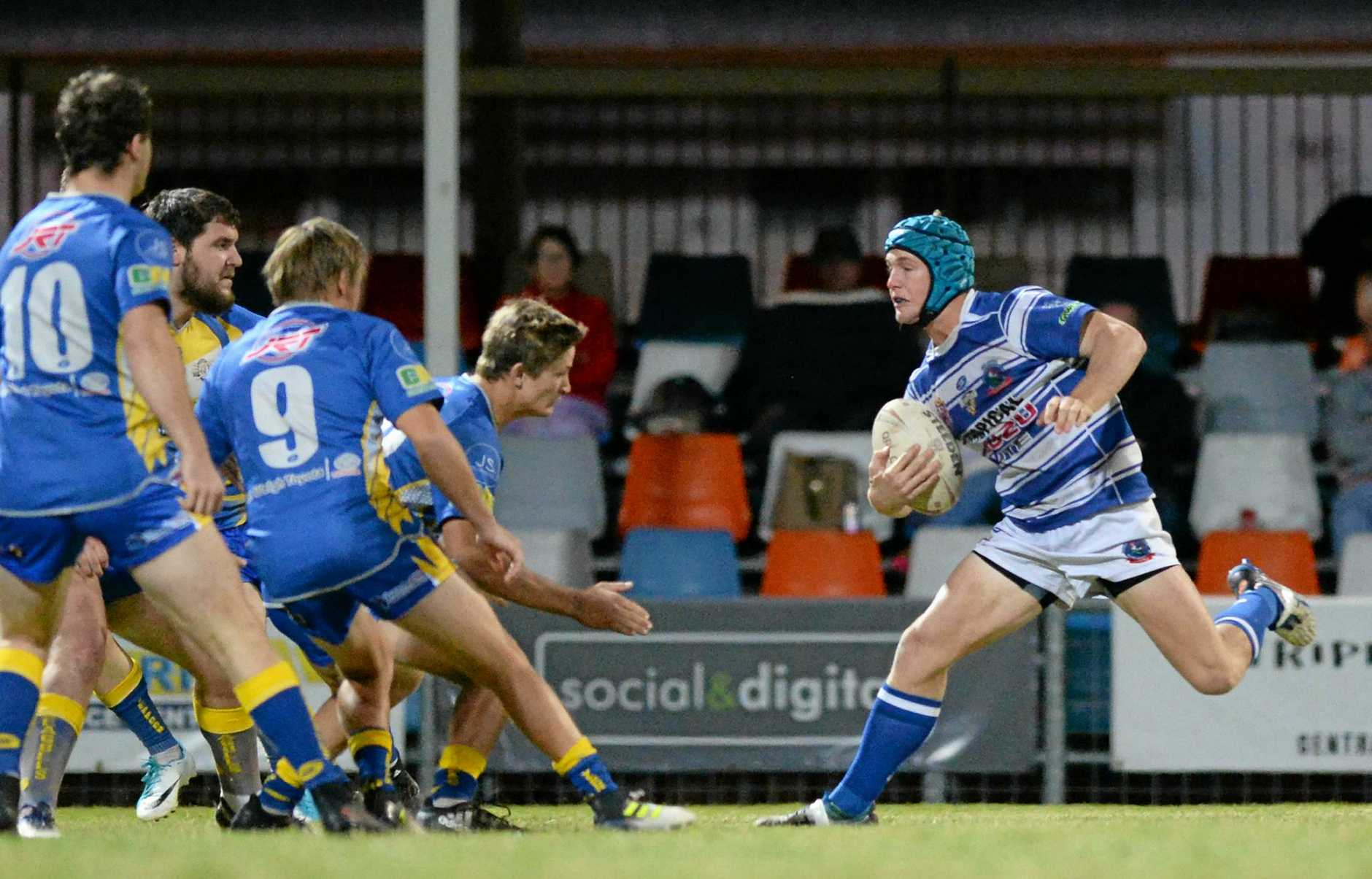 FULL STRIDE: Rockhampton Brothers player Lachlan Norris charges into Yeppoon's defensive line in Saturday night's preliminary final.
