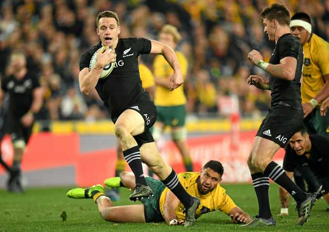 Ben Smith finds a break to run on and score a try for the All Blacks.