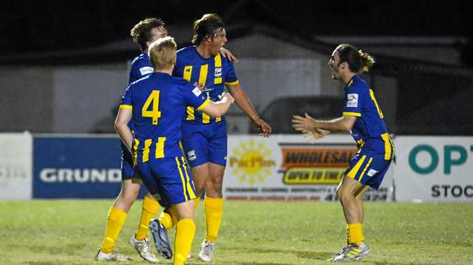 IN THE NET: The Waves captain Callum Hillier celebrates a goal with Warrick Stuart and Joe Williams in the NewsMail Cup final at Martens Oval.