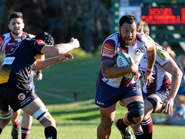 RUGBY UNION: Noosa Dolphins v Caloundra Lighthouse. Noosa's Wilson Enoka on the charge.