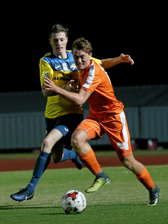 NPL game - FNQ Heat v South West Queensland Thunder at Barlow Park. Thunder's Nicholas Edwards and Heats Kasper Holmbech. PICTURE: STEWART McLEAN