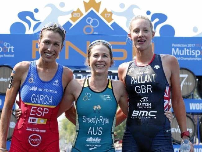 WORLD TITLE GOLD: Australia's Felicity Sheedy-Ryan (centre) has won the elite women's duathlon world title from Spain's Margarita Garcia Cañellas (left) and Emma Pallant from Britain.