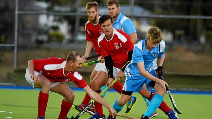 Brothers' Laird McKay in heavy traffic. Maryborough Hockey Div 1 men's semi finals: Maryborough Brothers (blue) v Colts (red).