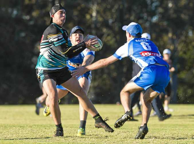 ALMOST GOT HIM: Brayden Insley of Rebels Hurricanes avoids two Saints players.