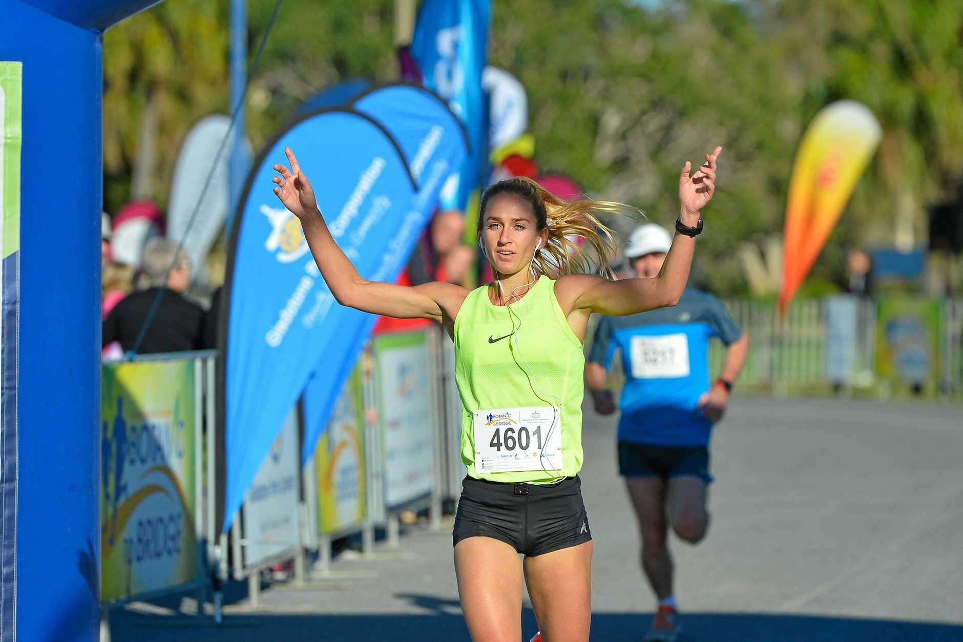 TOP RUN: Chloe Turner celebrates crossing the line first to be named 2017 Botanic to Bridge Open Female winner.