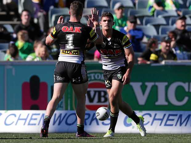MILESTONE: Penrith Panthers' Nathan Cleary (right) celebrates with Dylan Edwards  after scoring a try  against Canberra Raiders yesterday.
