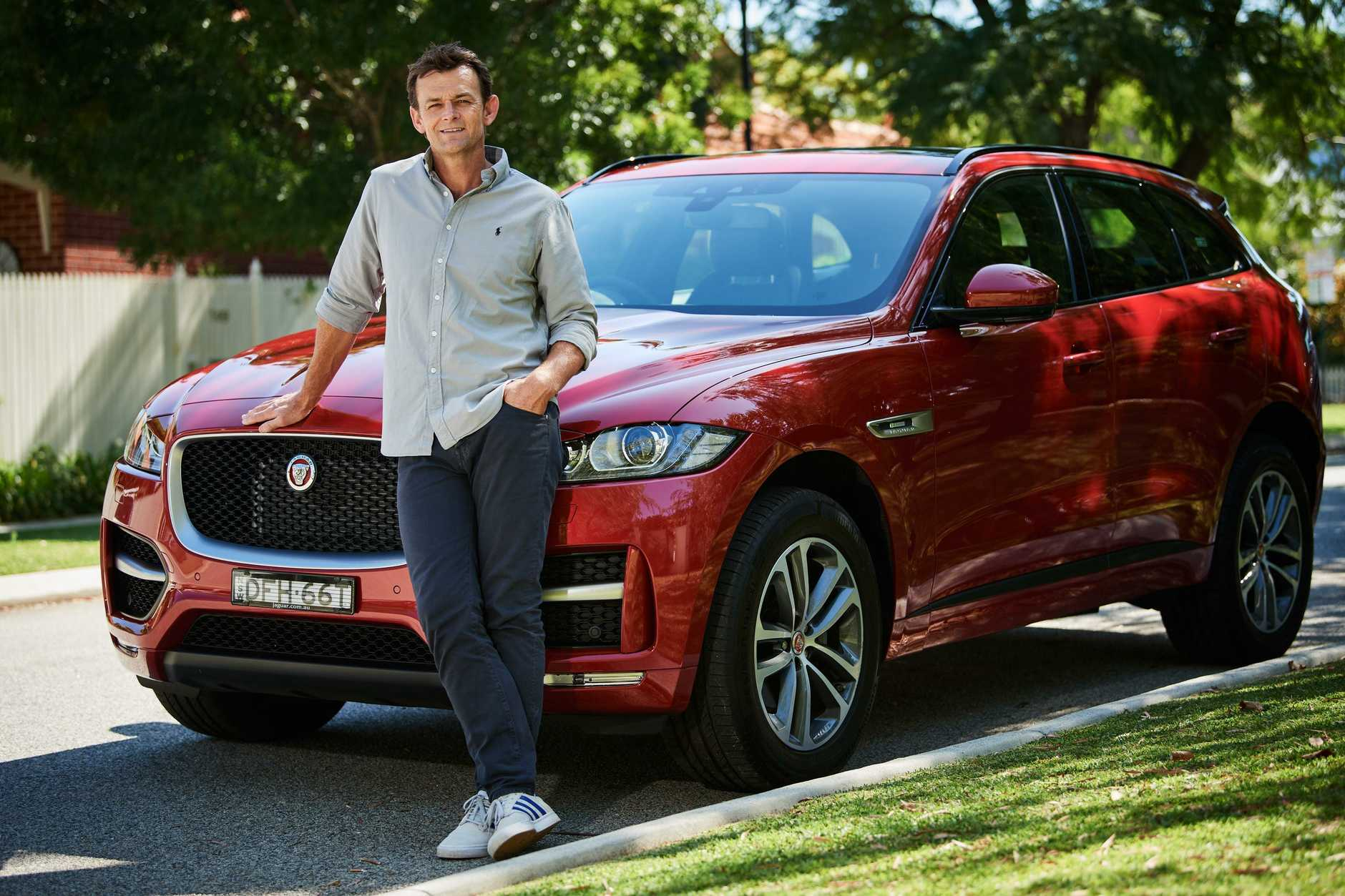 Former cricketer Adam Gilchrist with his Jaguar F-Pace.