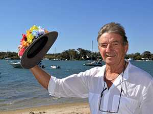 TOP HAT: Patrick Roach adds some race fashion to an Akubra for the Birdsville Races.