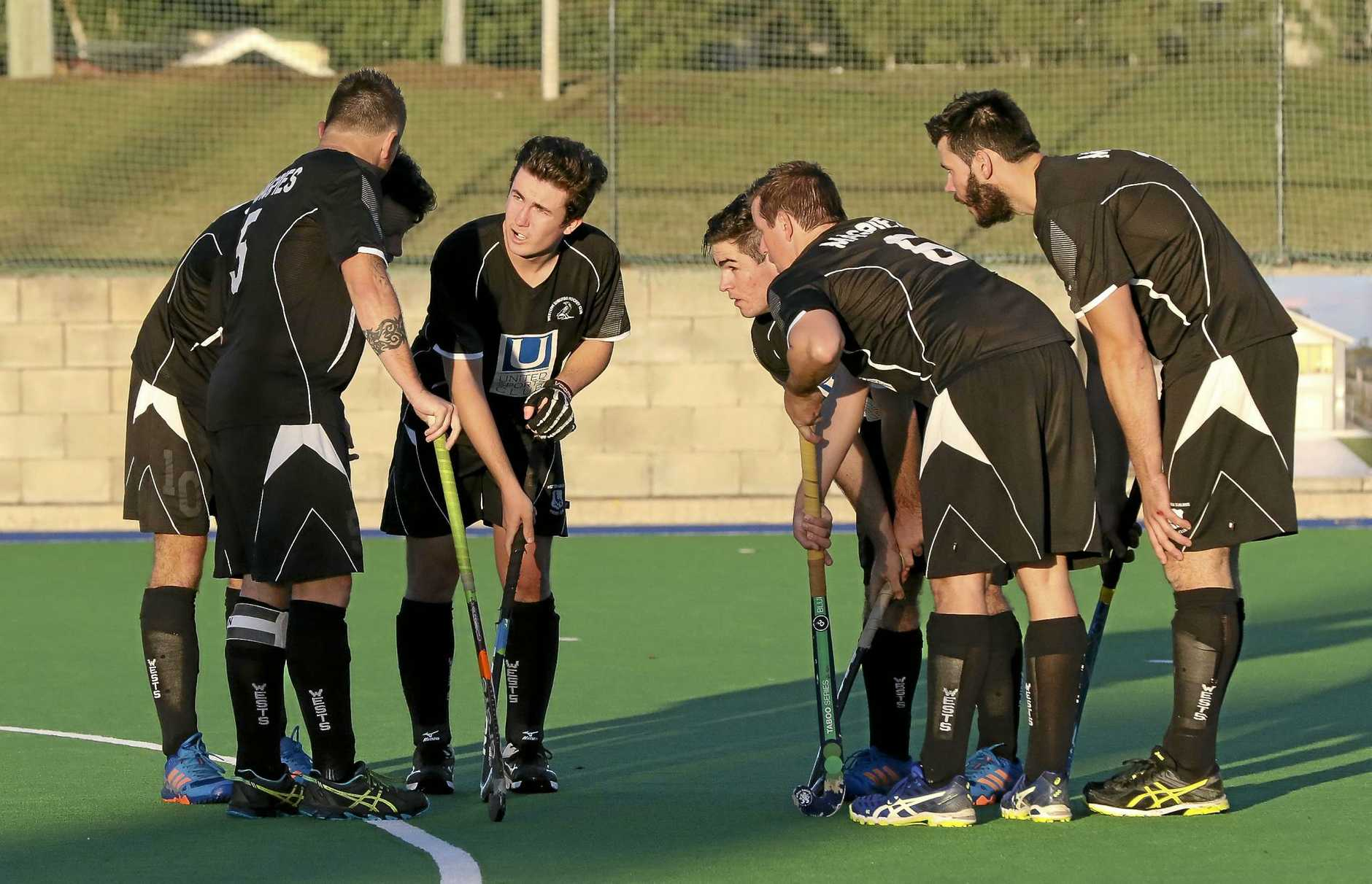 TALKING TACTICS: Wests' A Grade players plot their next move during a recent game at the Ipswich Hockey Complex.