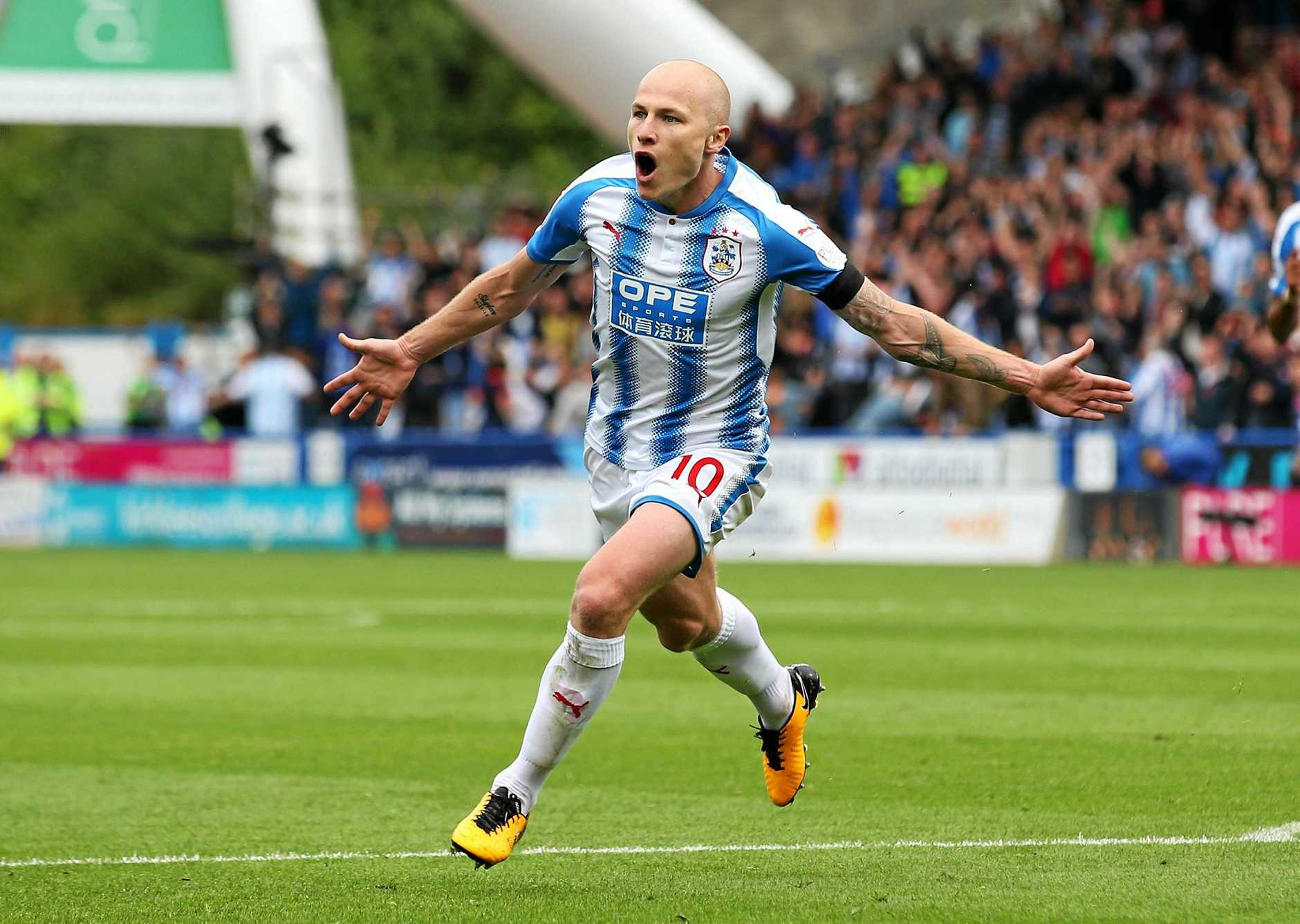 Aaron Mooy of Huddersfield Town celebrates scoring the winning goal against Newcastle.