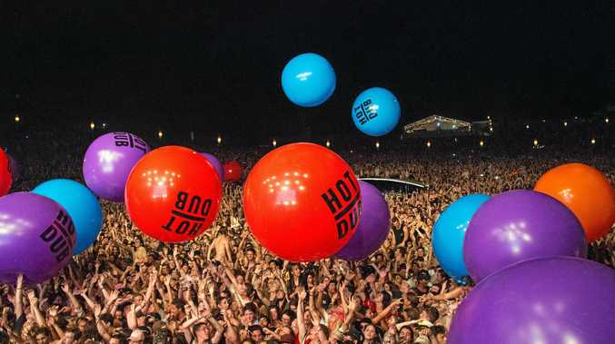 Revellers enjoy the props during Hot Dub Machine's show at Falls Festival Byron Bay on New Year's Eve.