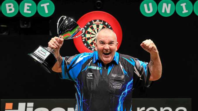 Phil Taylor celebrates winning the Unibet Melbourne Masters title. 