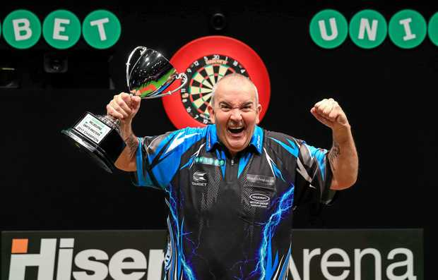 Phil Taylor celebrates winning the Unibet Melbourne Masters title.  Picture: Tim Murdoch/PDC