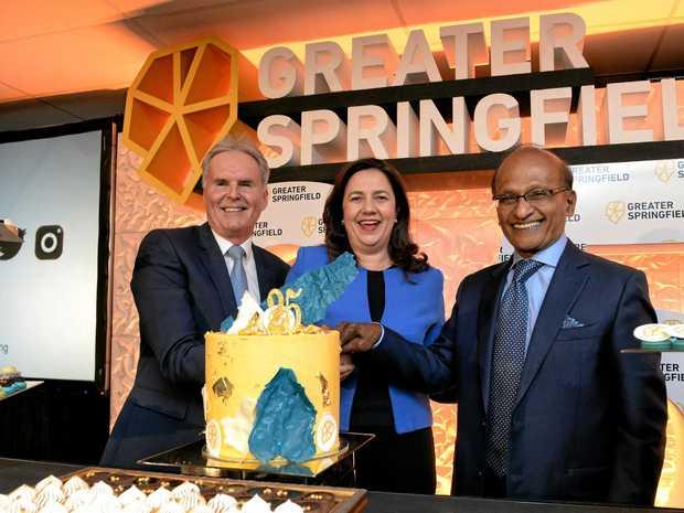 Springfield Land Corporation deputy chairman Bob Sharpless, Queensland Premier Annastacia Palaszczuk and chairman Maha Sinnathamby celebrating 25 years of Greater Springfield.