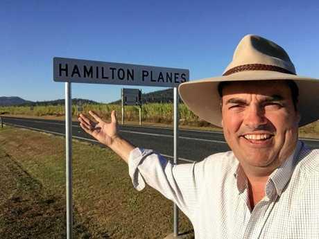 MP Jason Costigan at the Hamilton Plains sign.