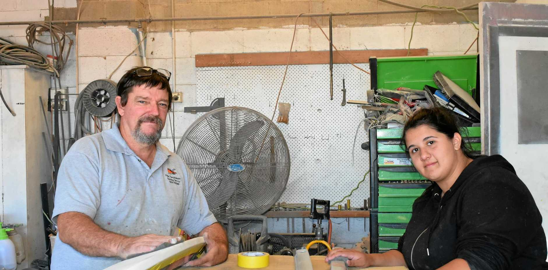 LEARNING JOURNEY: Owner of Peter Farquharson's Painting Services Peter Farquharson has second-year apprentice Macayla Dalziell on deck.