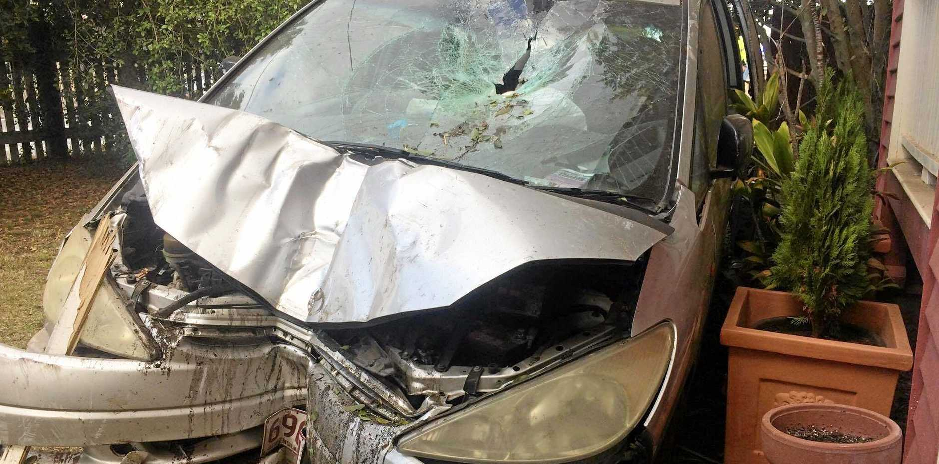 Five people were lucky to escape harm after their car crashed through two fences and was speared by a star picket.