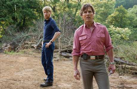 Domhnall Gleeson and Tom Cruise in a scene from American Made.
