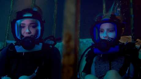 Mandy Moore and Claire Holt in a scene from the movie 47 Metres Down.