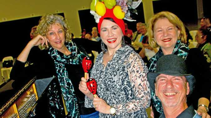 Helen Peters, Elisabeth Wallis-Gaedtke, Evalee Sharples and Kemal Avunduk rehearse for Fascinating Rhythm, Sunshine Coast Oriana Choir's performance of hot jazz, sizzling samba, Latin beats and smooth swing sounds at Lake Kawana Community Centre on August 26-27.