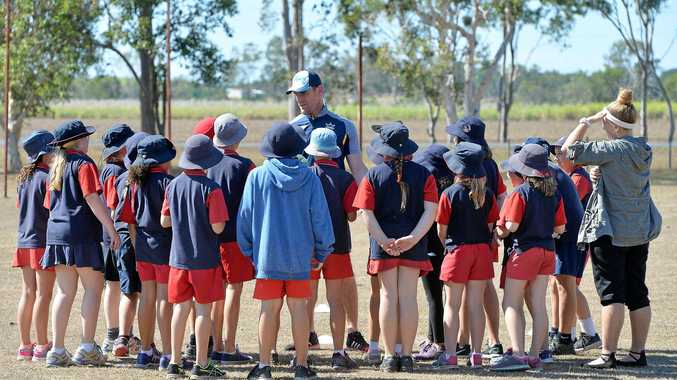 Cowboys star Brent Tate talks to a group of Alligator Creek State School students this week.