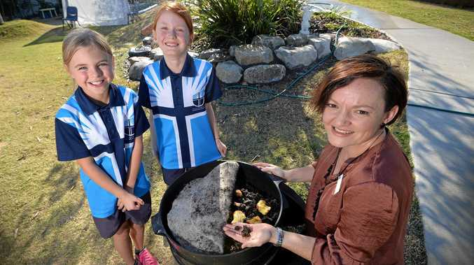 Coolum Beach Christian College has recently started a new 'waste warriors' group. Sage Butler and Tasmin O'Keefe tend to the worm farm with Cath Knijnenburg.