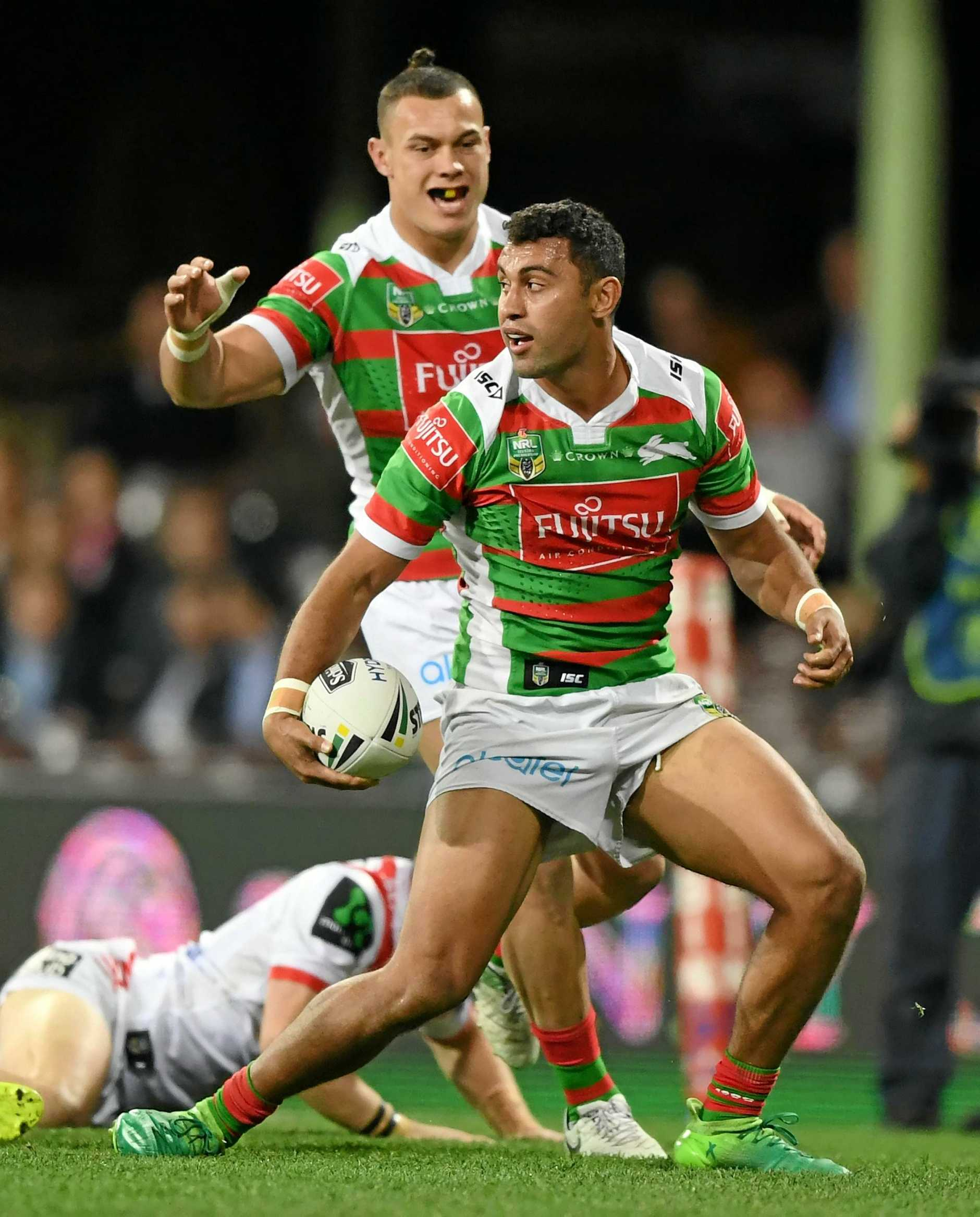 Alex Johnston of the Rabbitohs celebrates after scoring a try against the Dragons in round 22.