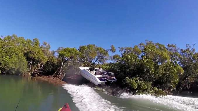CLOSE ENCOUNTER: The moment a hooning speed boat propelled up into the mangroves of Ross Creek narrowly missing kayaker Adam Williams.