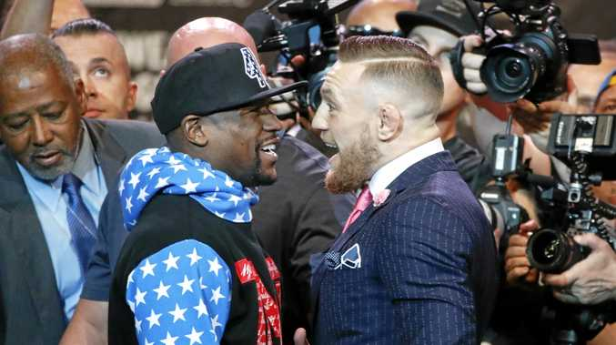 Floyd Mayweather Jnr (left) and Conor McGregor exchange words in Los Angeles.