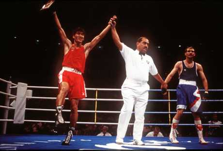 Somluck Kamsing of Thailand celebrates after his gold medal victory against Serafim Todorov of Bulgaria in the 57kg boxing final at the 1996 Olympics in Atlanta.