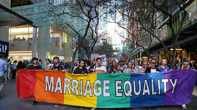 AUSTRALIA, Sydney: Supporters carry a banner reading 'marriage equality' during a rally for 'Marriage Equality' held in Sydney on August 13, 2016 before the return of Parliament. (AAP Image/NEWZULU/Richard Milnes).