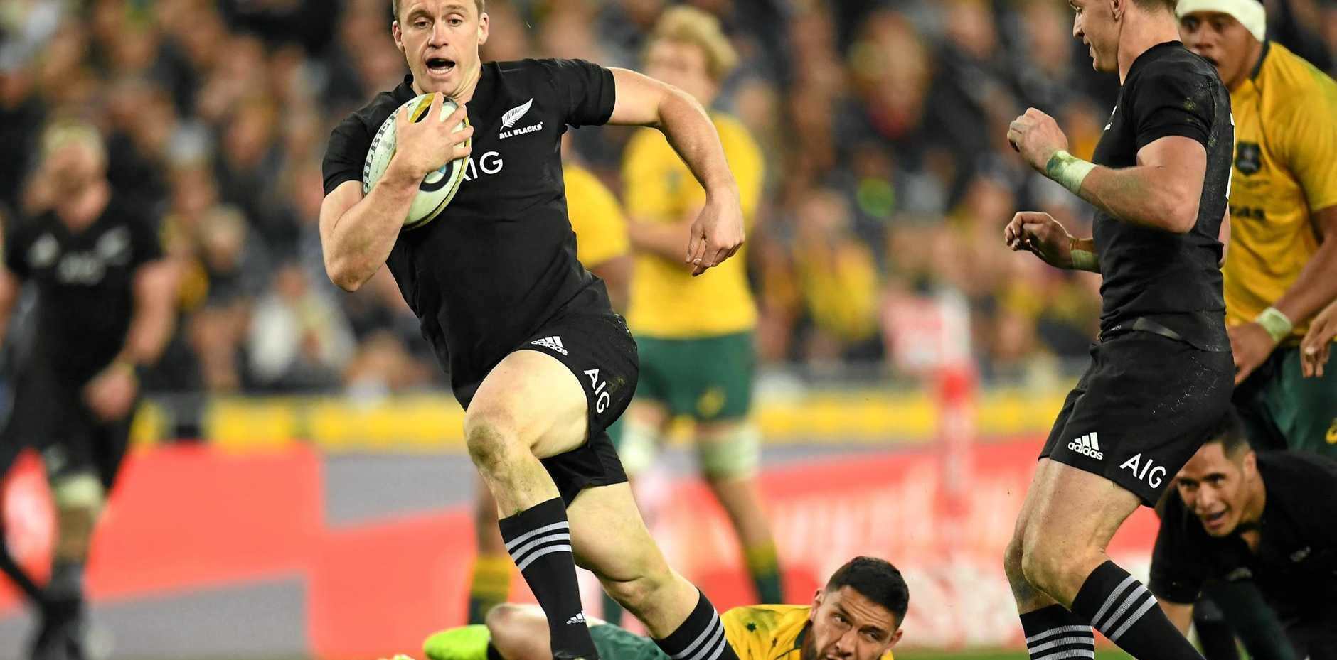 All Black Ben Smith leaves the Wallabies in his wake to run on and score a try during game one of the Bledisloe Cup