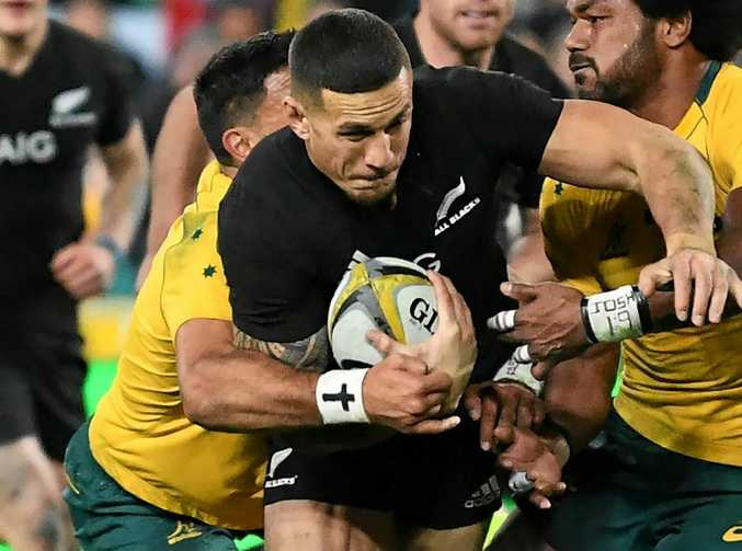 Sonny Bill Williams of New Zealand powers through the Australia defence to score in the Bledisloe Cup.