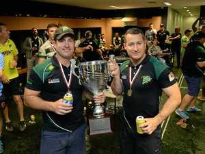 READY: Jets coaches Shane and Ben Walker with the Intrust Super Cup premiership trophy in 2015. The duo will apply for the Titans top job.