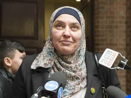 Mama Dunia addresses the media outside court.
