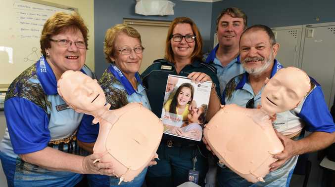 IN AN EMERGENCY: Hervey Bay Local Ambulance Committee volunteers Merryn Napier, Robin Fairleigh, Helen Donaldson (station officer in charge), Wayne Frecklington and Ian Farrell prepare the Mini Anne CPR Torsos for this weekend's CPR training sessions at Scarness Park.
