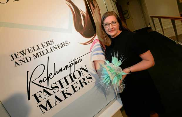 Kim Withers with a fascinator which is currently on display as part of the Jewellers and Milliners exhibition at the Rockhampton Art Gallery.