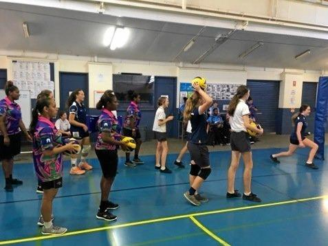 Thursday Island and Burnside High students do volleyball drills.