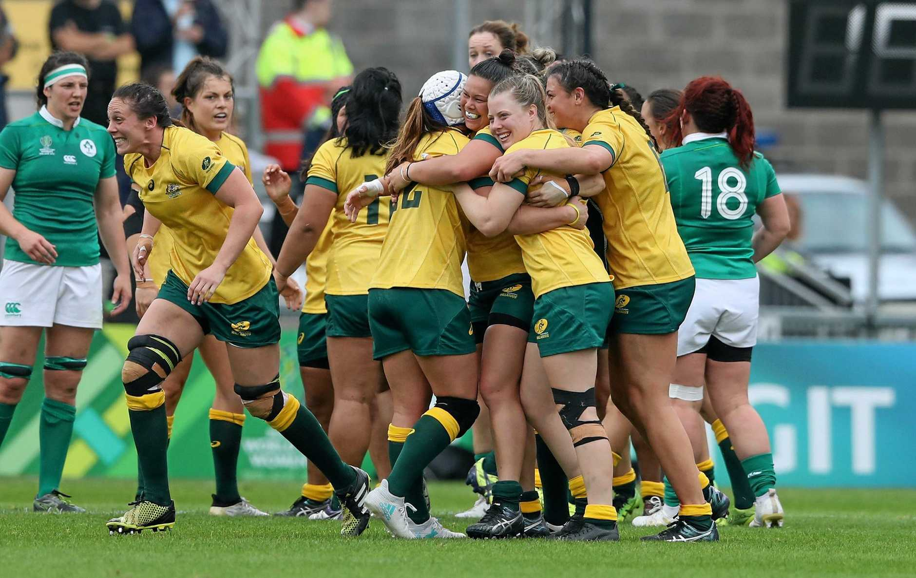 Australia's players celebrate after their victory during the Women's Rugby World Cup 2017 match between Ireland and Australia.