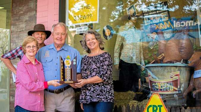 WINNER:   Lyn Grady, Tony Goodman, Tom Grady and Sally Garrahy outside the winning shop front.