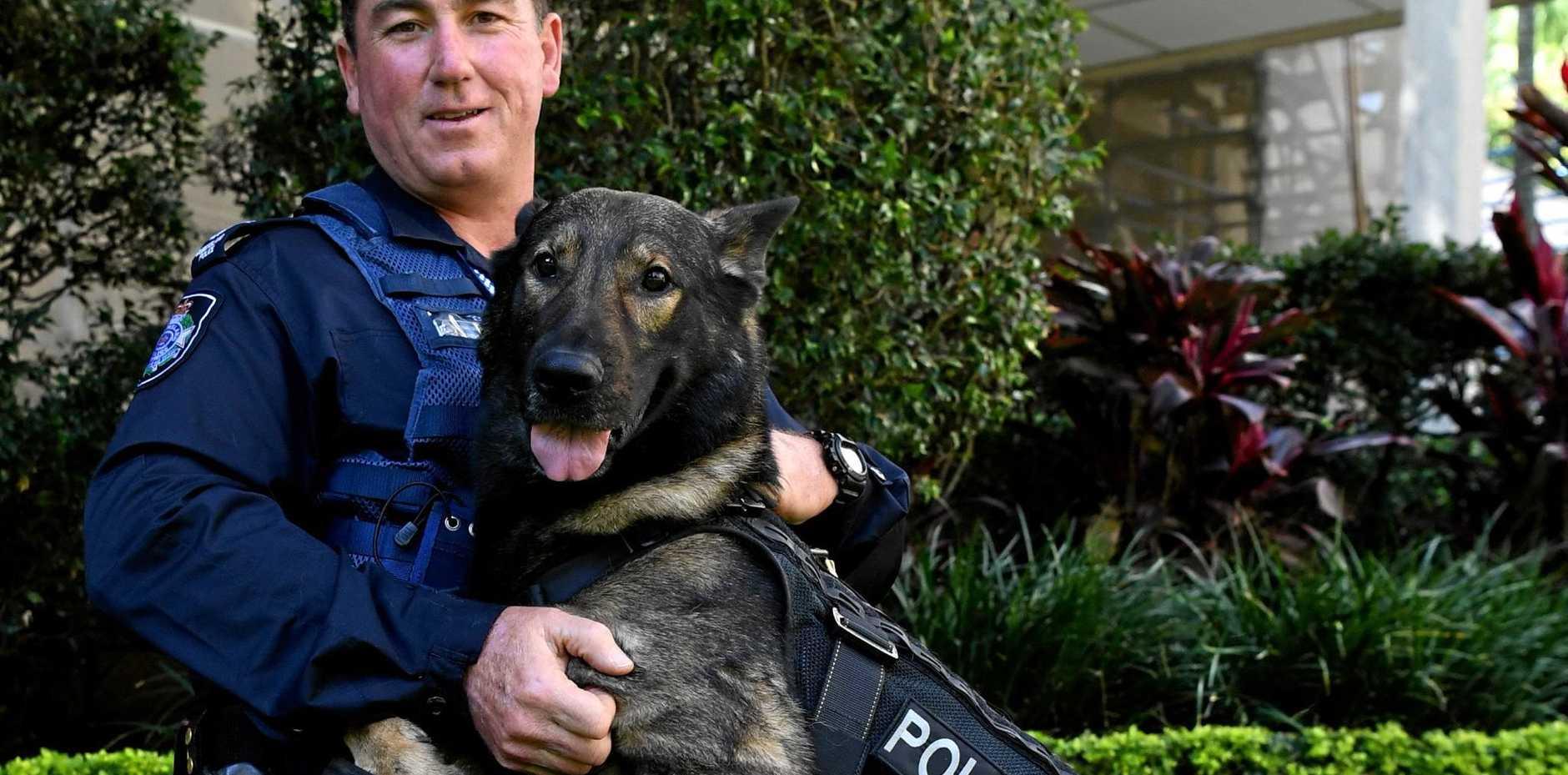 BOND: Acting Senior Sergeant Trevor O'Neil and police dog Kaleb.