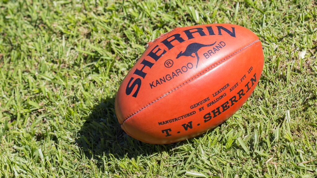 A Queensland Australian rules player has been banned from the sport for 20-years after kicking another player in the head during a game at the weekend.