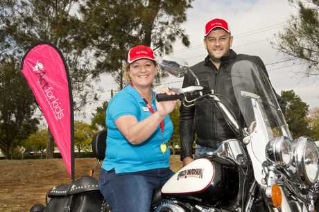 KIDS BENEFIT: ( From left ) Heidi Fowler from ACT For Kids in Toowoomba and Rider Kurt Kratzmann. Ride for a Cause raising money for ACT For Kids. Thursday, 24th Aug, 2017.